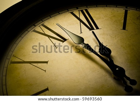 Close up of a retro clock and time is 12 o'clock.  Concept of time. - stock photo
