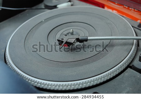 Close-up of a retro turntable deck, indoor shot with selective focus - stock photo