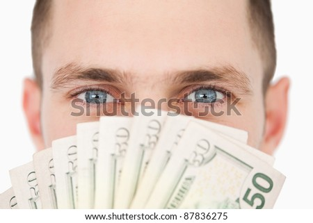 Close up of a rich businessman against a white background - stock photo