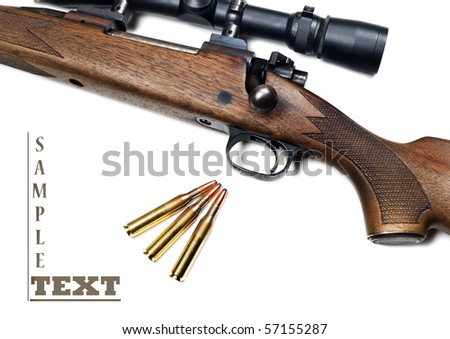 Close up of a rifle and bullets on a white background with space for text - stock photo