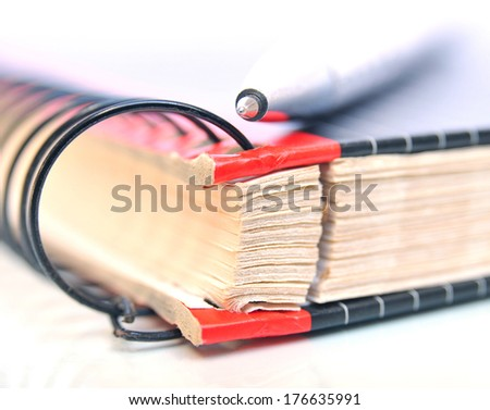 Close up of a ring binder with pen on top - stock photo