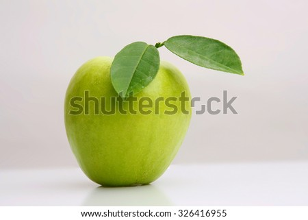 Close-up of a ripe granny smith apple isolated on a light grey background./Green apple - stock photo