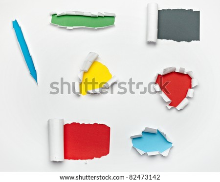 close up of  a ripped paper hole on white background