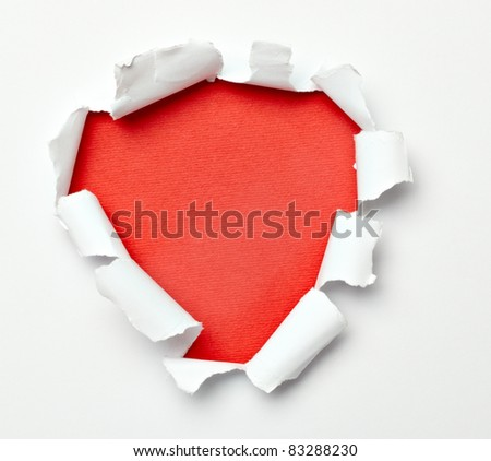 close up of  a ripped paper hole on white background - stock photo