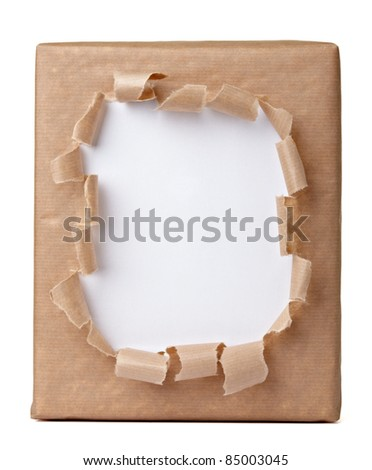 close up of a ripped wrapped box on white background - stock photo