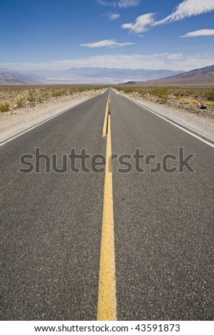 Close-up of a road in the desert - stock photo