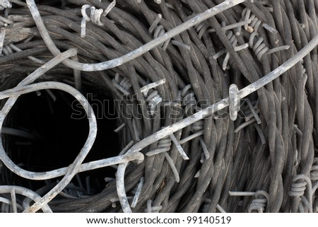 close up of a roll of barb wire background - stock photo