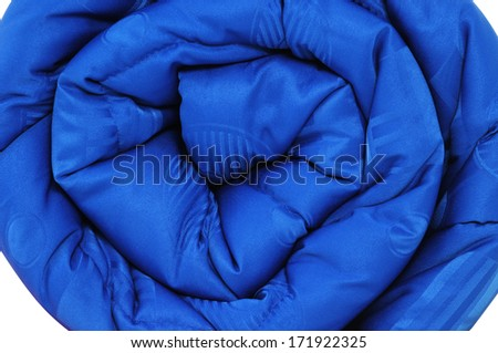 Close up of a rolled up comforter, smoothness and softness concept. - stock photo