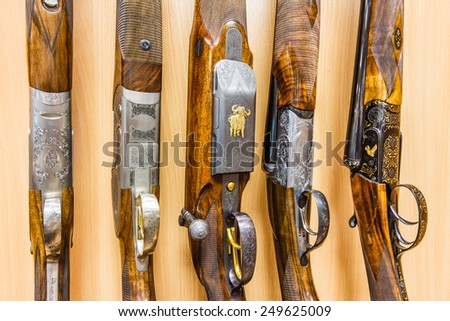 close up of a row of guns displayed in gun shop - stock photo