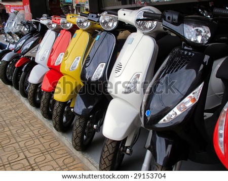 Close up of a row of motor bikes - stock photo