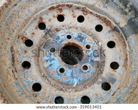 Close up of a rusty corroded car wheel