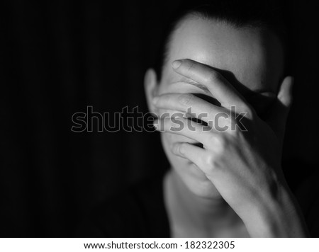 Close up of a sad and depressed woman. Black and white portrait. - stock photo