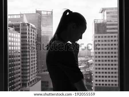 Close-up of a sad and depressed woman deep in thought. - stock photo