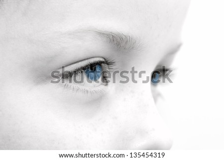 close up of a sad childs eyes - stock photo
