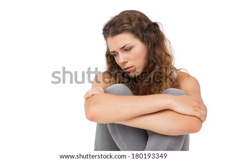 Close-up of a sad young woman over white background - stock photo