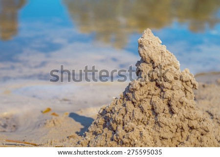 close-up of a sand castle on the river beach - stock photo