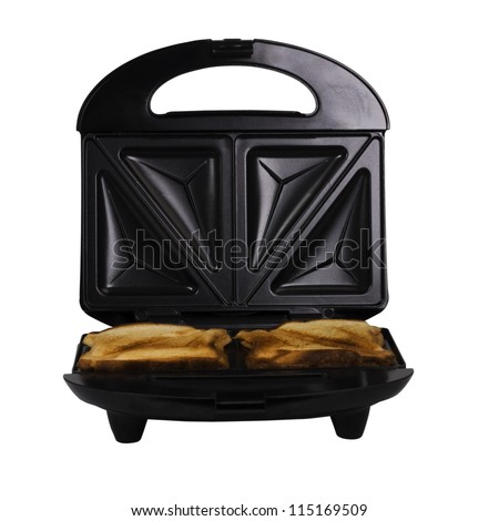Close-up of a sandwich toaster with bread slices