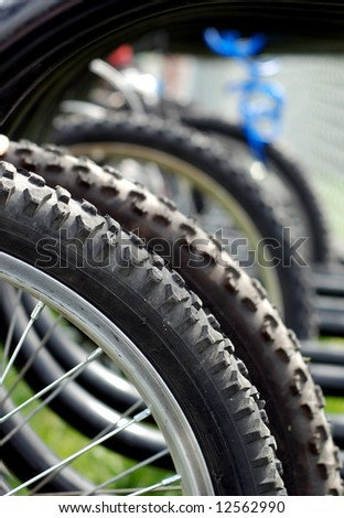 Close-up of a schoolyard bicycle rack detail on the tire tread - stock photo