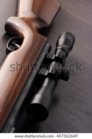 Close up of a scope mounted on a rifle