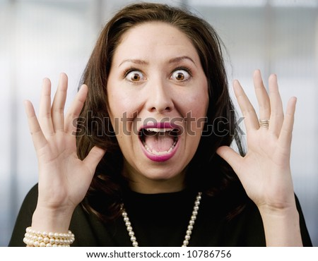 Close Up of a Screaming Hispanic Woman - stock photo
