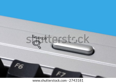 Close-up of a search icon button on a computer keyboard. - stock photo