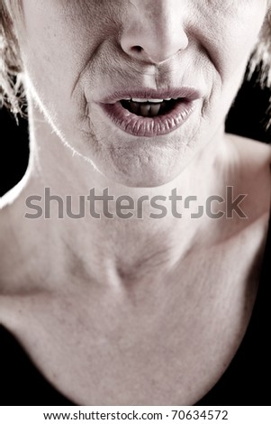 Close-up of a Senior Woman Mouth, actress on stage - stock photo