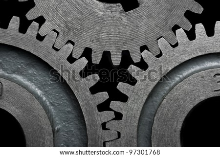 Close-up of a set of metallic gears. - stock photo