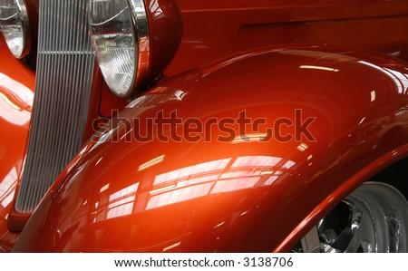 Close-up of a shiny orange hot rod - stock photo