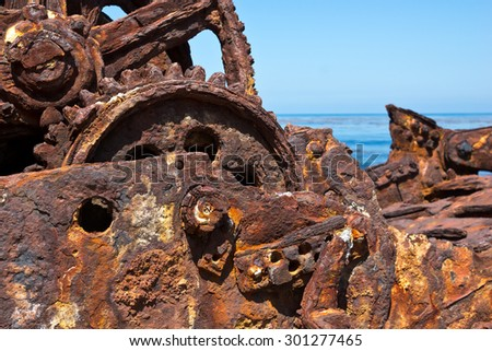 Close up of a shipwreck and the metal that turn to rust. Selective focus is in the middle.