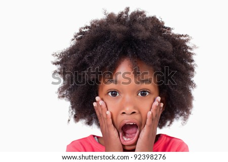 Close up of a shocked girl against a white background