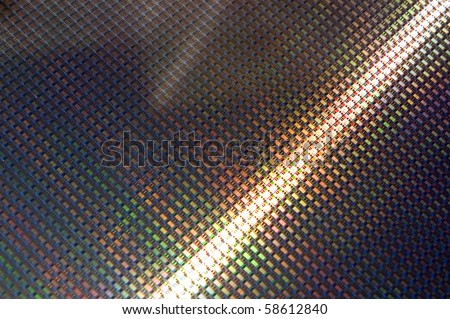 Close up of a silicon wafer of SIM computer chips. - stock photo