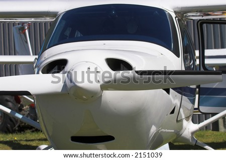 Close up of a single engine prop plane - stock photo