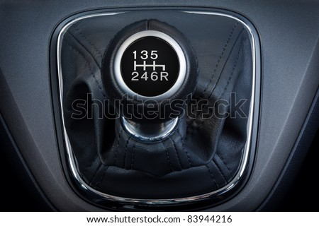 Close-up of a  six speed manual gear stick. - stock photo