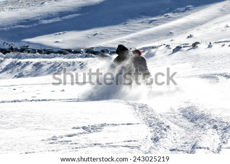 Close up of a skier while skiing on the mountain - stock photo