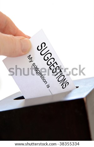 Close-up of a slip being placed in a suggestion box over a white background - stock photo