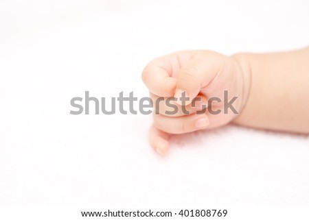 Close up of a small baby hand