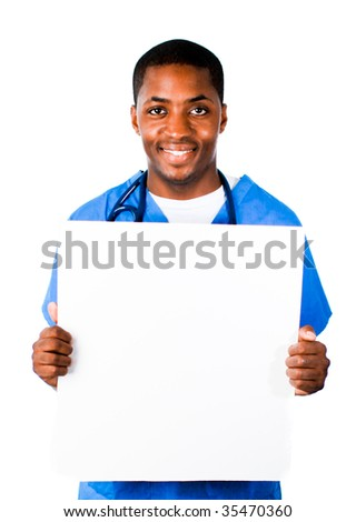 Close-up of a smiling Afro-American doctor wearing scrubs and holding a white card - stock photo