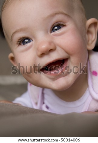 close up of a smiling baby girl - stock photo