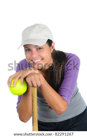 Close up of a smiling female softball player leaning on a wooden bat. Vertical format isolated on white.