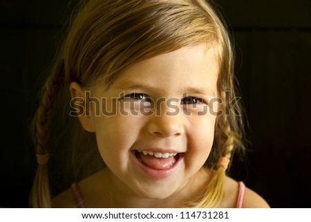 Close up of a smiling girl with braided hair - stock photo