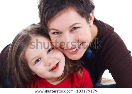 Close-up of a smiling mother and her 3-year-old daughter - isolated on white - stock photo