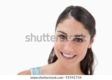 Close up of a smiling woman against a white background