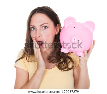 Close-up Of A Smiling Woman Holding Piggybank Over White Background - stock photo