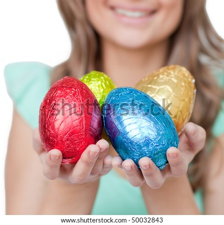 Close-up of a smiling woman showing colorful Easter eggs - stock photo