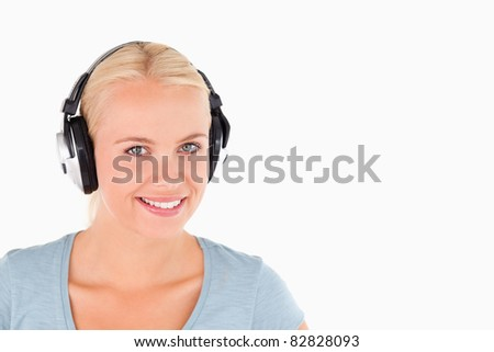 Close up of a smiling woman with headphones in a studio