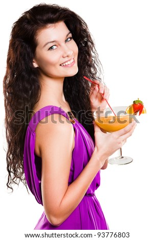 Close up of a smiling woman with orange juice - stock photo