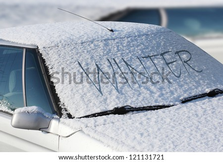 Close up of a snow-cowered car. Winter transportation and insurance concept. - stock photo