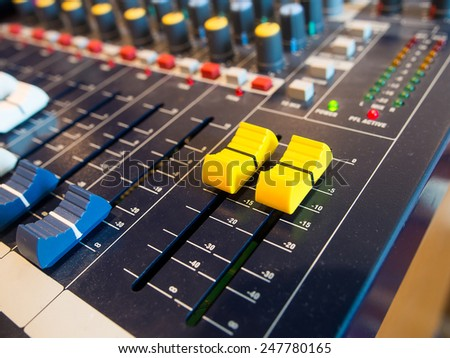 Close up  of a sound mixer buttons control. - stock photo