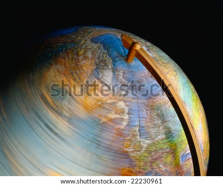 Close up of a spinning globe on black - stock photo