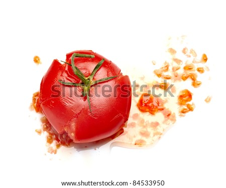 close up of  a splattered tomato on white background - stock photo